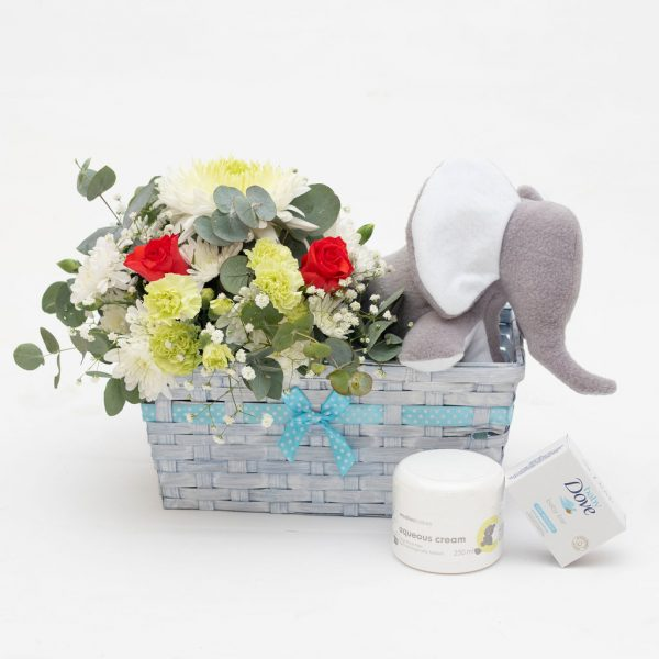 Fluffy Elephant Hamper for a Boy. Our Fluffy Elephant Hamper for a Girl consists of a floral tin arrangement, a soft fluffy elephant, a baby soap and aqueous cream in a basket. This is a wonderful gift for mum and baby. We can deliver in Port Elizabeth, Despatch and Uitenhage.
