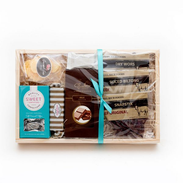 The Blue Sweet and Savoury Hamper is filled with a selection of sweet and savoury treats, consisting of assorted biltong products, artisan chocolates, crisps, nougat and toffees.